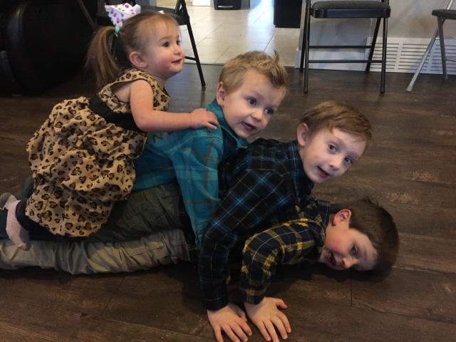 Mathias, Noah, Isaiah, Naomi in a kid pile.