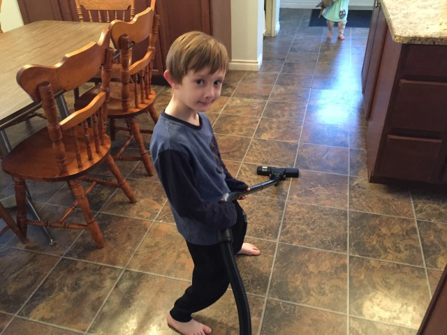 Mathias does the vacuuming.