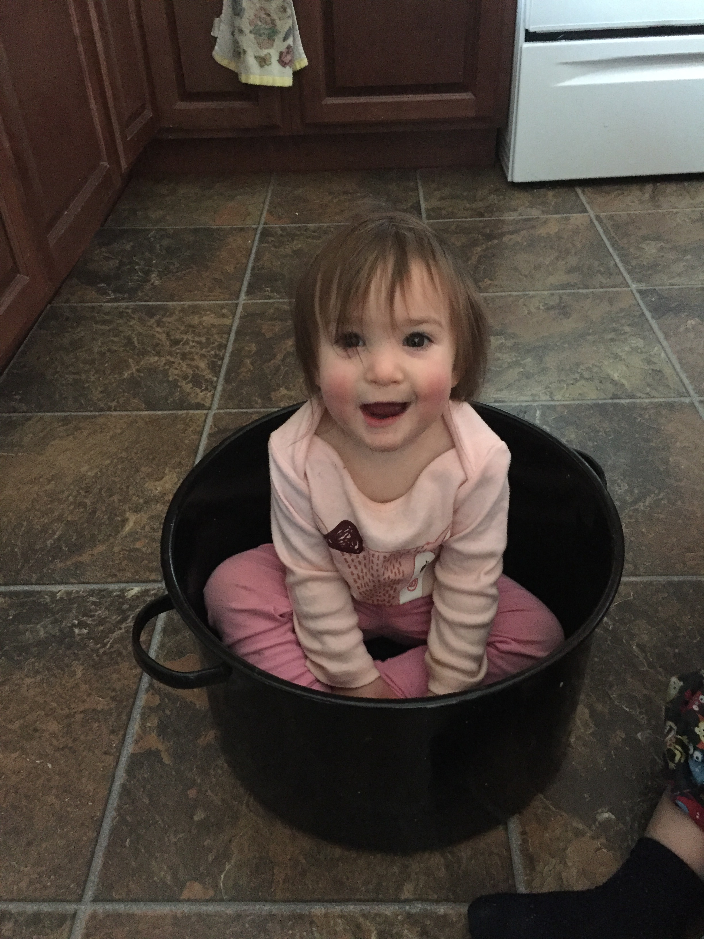 Girl in a canning pot.